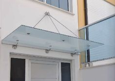 Door canopy with cable support and fixings