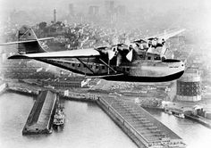 A Pan American Airways Martin M-130 flying boat, the China Clipper, leaves San Francisco Bay for Manila carrying the first United States trans-Pacific air mail on Nov. 22, 1935.  In the background is Coit Tower and the San Francisco skyline.  (AP Photo/PanAm) Photo: AP / SF