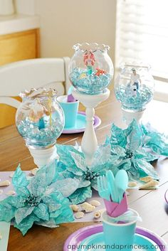 The little mermaid birthday party decorations. Dollar fish bowls with aqua rocks and mermaid toys is simple but adorable! Turquoise Table Little Mermaid Decorations Mermaid Theme Birthday, Little Mermaid Birthday, Little Mermaid Parties, The Little Mermaid, Birthday Party Themes, Birthday Ideas, 5th Birthday, Birthday Table, Mermaid Themed Party