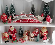 I love vintage Santa figures, and mugs and plates and......
