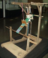 This is what a traditional kente loom looks like. Kente weavers are able to set up their loom and start weaving in a matter of hours.