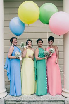 I LOVE the idea of having several bridesmaids in the same dress, but different colors- and I think the balloons just make it better!