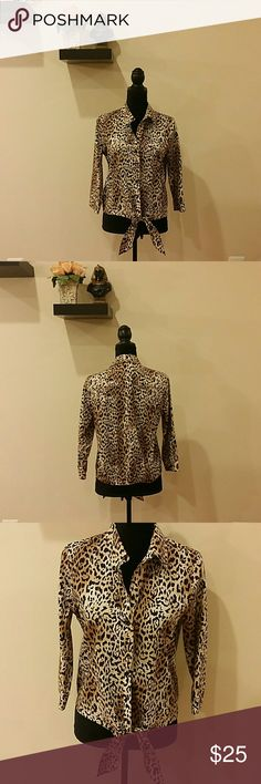 Chicos size 0 no iron button down shirt NWOT Description : Chic l cheetah print l button down shirt l note there is a  bow tie in the front at the bottom.  Material : 100 % cotton.  Color : brown and black.  Condition : Excellent NWOT new without tags.  Measurements will be provided on request.  Discount  with bundles No trades  Chico's Tops