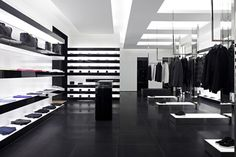 Dior Homme store inside the Mall of the Emirates in Dubai. Simple juxtaposition of black and white together with indrect lighting makes for a calm and clean atmosphere.