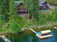 Coeur d'Alene Lake, Rockford Bay, 90' frontage, 6 bedrooms, 4 baths, 4440 sq ft, custom log home in immaculate condition, granite countertops, new dock with covered slip, community sewer & water.