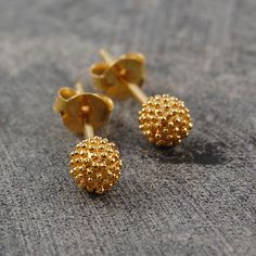 So many Otis Jaxon designs are inspired by nature. These delightful gold-plated stud earrings are reminiscent of sycamore seed pods so common in London's parks. #Otisjaxon #Jewellery #Accessories