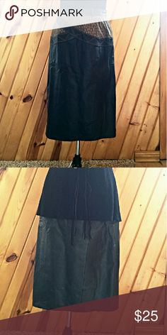 Pelle Leather Skirt Black Leather Skirt with Brown Accents. Zips up the back with top snap. Pelle Skirts Pencil