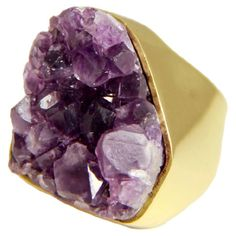 Make a stylish statement with this striking ring, showcasing an organic-inspired amethyst stone set in 18-karat gold-plated brass.