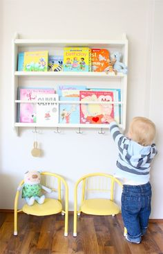 Great bookshelf - hang Library bags on the hooks - repurposed plate rack from Ikea