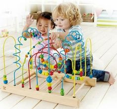 This low profile Tunnel Mountain Bead Maze Toy offers a generous amounts of blue and yellow arches, green zig-zags and curling loops that tower over a giant red tunnel. All wires are securely anchored to the wooden base for safety. Excellent co-operative play center for waiting areas, pre-schools and playrooms.  #kidkraft #sensoryedge #waiting room http://www.sensoryedge.com/tunnel-mountain-bead-maze-toy.html