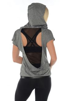 Our Women's Athleisure Short Sleeve Hoodie Open Back Vegan Leather & Mesh Cut Outs is the perfect street chic and edgy Hoodie to wear over your workout top when going or coming from the gym or yoga/Pi