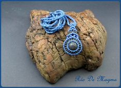 Macrame blue and black pendant with volcanic stone. Necklace with lava rock…