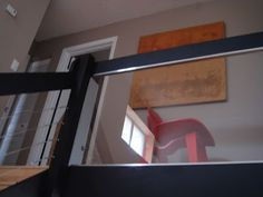 DIY: How to install a glass or plexiglass railing in your home for a clean, modern look.