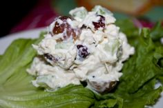 Chicken Salad =  2 (10 ounce) cans chicken chunks, drained   1 cup seedless grapes, halved  1/2 cup sliced almonds  1/3 cup dried cranberries (craisins)  3/4 cup mayonnaise  Mix together chicken, grapes, nuts,  cranberries, and mayo. Chill.