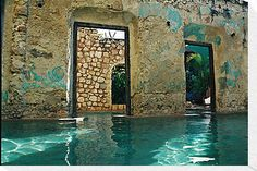 Swimming Pool that utilizes ruined walls and its passageway/doors in Mexico