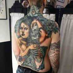 Tattoo woman with skeleton and flowers   #Tattoo, #Tattooed, #Tattoos