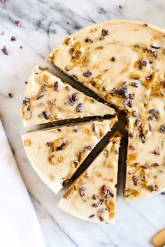 Vegan Cookie Dough Cheesecake is a two step recipe that yields a healthy(ish) dessert. Big chunks of gluten-free cookie dough and swirled through a sweet and tangy cheesecake filling. | CatchingSeeds.com