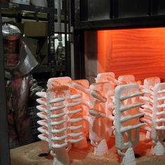 Following a firing in the kiln, molds are prepared to be filled with molten metal.