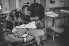 This dad who was filled with emotion upon holding his baby girl for the first time.  Erin Shepley Photography / Viaerinshepleyphotography.com