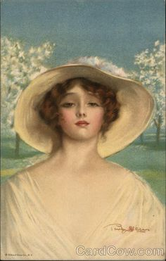 Beautiful Woman with Hat in Orchard