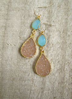 FLASH SALE 25% - Were $135, now $101 for a limited time only!  Glittering natural jasper quartz druzy drops sway from beneath bezels of aqua blue chalcedony in gold vermeil. Druzy stones are a gorgeous color and they sparkle brilliantly! They are framed in shiny gold plate along the side walls for a polished finish - the backs are left natural to allow light to pass through. High quality aqua blue chalcedony gems are fully faceted on front and back sides and bezel set in polished gold…