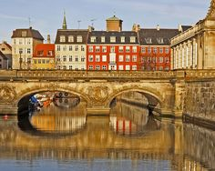 Recommended in Copenhagen on a sunny day - take a walk in the medieval city along the canals ... Here Marble bridge, crossing Frederiksholms Kanal going in the the courtyard behind Christiansborg Castle.
