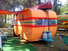 Love the bright colors painted on this vintage travel trailer!