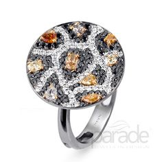 For my Mom, I think she would LOVE IT!!! From Parade Design The Reverie Collection offers a new convertible style that can be worn as a ring or pendant. A sophisticated take on the leopard-print trend, fancy color diamonds are scattered throughout swirling black and white diamonds.