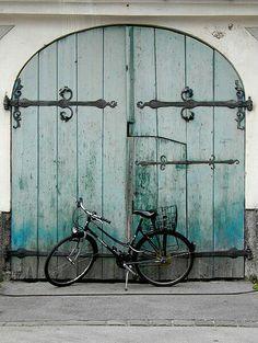 Black Bike Turquoise Door
