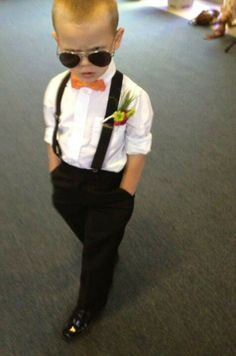 Ring bearer with suspenders! This is too cute. I like the outfit
