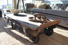 Vintage Hand Truck/Cart topped with an OLD Barn door makes a coffee table.