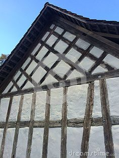 Photo about A beautiful historic timber frame house in Switzerland in a traditional germanic style of half-timbered building called colombages. Image of beautiful, timbered, museum - 70956120
