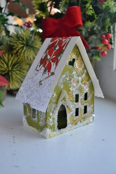 Made using vintage Christmas cards this Glitter House was inspired by vintage putz houses. This is the large display decor size. OOAK gift.