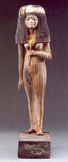 """Funerary statuette. Also from Medinet Gurob is the beautiful statue of Lady Resi.  It was found by F. Petrie in the tomb of Amenemapt. Res was daughter of Amenemapt? Found at tomb number 22, Gurob, Egypt.  It bears the inscription """"the blessed Lady Resi""""."""