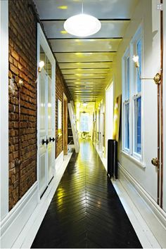 Love the glossy black painted chevron flooring with white border drawing your rye down this long brick-walled hallway.Work With What You Got! — Glamour Drops 2011 Interiors