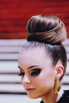 That high bun  and her gorgeous makeup!