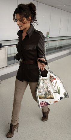 Who made Cheryl Coles' suede boots, jacket and floral bag that she wore at LAX airport on February 23, 2011? Purse – Stella McCartney  Shoes – Elizabeth and James  Jacket – Rag and Bone
