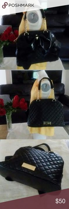 """Betsey Johnson Quilted Black Bow Bag Very good condition vegan bag Gold tone hardware has some tarnish spots but to me they blend in Clean interior Large patent leather bow adorns one side Base 5"""" x 13"""",  height 10""""  Strap drop about 9"""" Smoke free  Satchel/shoulder bag Betsey Johnson Bags Satchels"""
