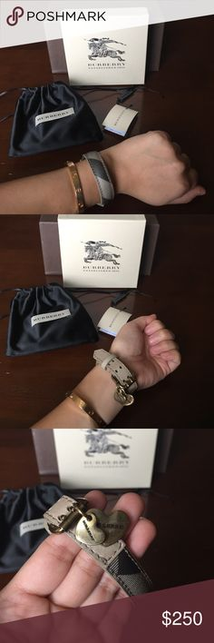 Burberry Smoked Check with Hanging Hearts Bracelet Burberry Smoked Check with Hanging Hearts Woven Leather Bracelet.  Size medium, but has 3 adjustable holes.  Excellent condition.  Includes item tag, dustbag and box.  Smoke free/pet free home. Burberry Jewelry Bracelets