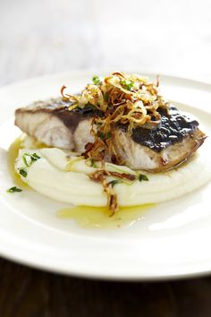 Crispy Fish on a Cauliflower Puree with Caramelized Onions
