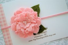 Felt Flower Headband  - Felt Flower Headband in Pink  - Newborn Baby Headbands to Adult. $6.95, via Etsy.