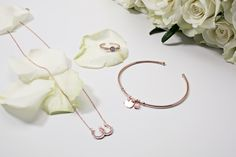 Horseshoes for luck and pink tones that coordinate with gold or silver rings. #loveargento #jewellery #weddingjewellery #rosegold #bride #bridal #flatlay #weddingflatlay