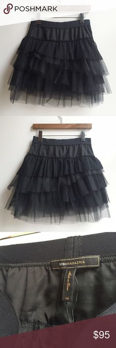 BCBGMaxAzria Black Mini Tulle Tutu Skirt Sz XS BCBGMAXAZRIA Women's Black Mini Tulle Tutu in Size XS is a cute and fun addition to your party wardrobe! 100% Polyester. Excellent pre-owned condition -- worn only once or twice and from smoke-free home! Elastic waistband pull-on style with a mid-rise waist and flared silhouette. Layered tulle tiers with an interior liner that stops just before the last couple tiers, showing off some of the tulle. It's even machine washable, which is always a…