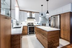 Love this kitchen. I like the style of the wood and that the upper white cabinets have clean, smooth lines that go all the way to the ceiling. I also like the interjection of black here and there. Kitchen Dining, Kitchen Decor, Small Kitchen Organization, Home Kitchens, Home Remodeling, Kitchen Remodel, Home Furniture, Interior Design, Home Decor