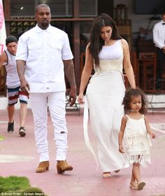 Quaity time: North delighted in bonding time with her parents, Kim Kardashian, 35, and rapper Kanye West, 38