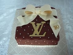 Last minute cake with the Louis Vuitton logo for a 30th birthday. I cut the logo with an exacto knife than luster with gold powder. Vanilla cake with buttercream filling all covered with quilted fondant.