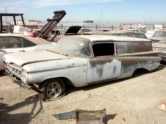 1959 Chevy Sedan Delivery waiting for someone to rescue.