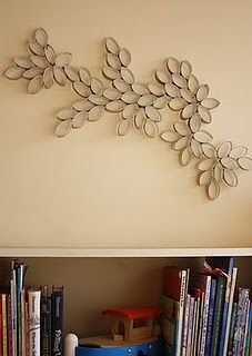 Empty toilet paper rolls usually land in the trash can but you may think twice before tossing them after you see all of these clever home decor pieces and paper crafts. Each and every one of these projects were made using empty toilet paper rolls. Toilet Paper Roll Art, Rolled Paper Art, Paper Wall Art, Diy Wall Art, Toilet Art, Paper Artwork, Diy Wand, Diy Décoration, Easy Diy