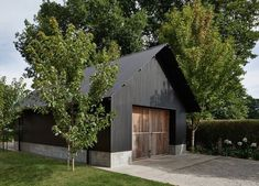 Adam Kane Architects achieve a pared back, modern redesign of home and its accompanying barn on an established garden plot in the Macedon Ranges. Black Shed, Black Barn, Metal Building Homes, Building A Shed, Building Ideas, Church Building, Metal Homes, Modern Barn, Modern Farmhouse
