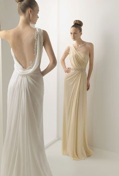 Brides: Soft by Rosa Clar�. Silk voile gown with bead-work and asymmetrical neckline. Available in ecru and beige.